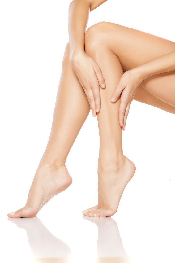 woman apply lotion on her legs