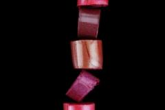 Lipstick stack on black background